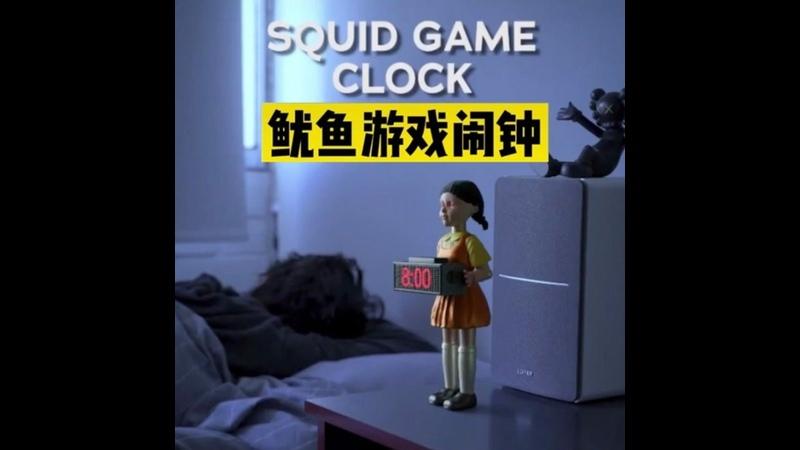 Стреляющий будильник в виде куклы убийцы из сериала Netflix Игра в кальмара